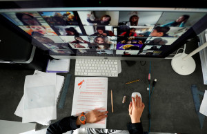 A student takes classes online with his companions using the Zoom app at home during the coronavirus disease (COVID-19) outbreak in El Masnou, north of Barcelona, Spain April 2, 2020. REUTERS/ Albert Gea TPX IMAGES OF THE DAY - RC2BWF9ONUM7